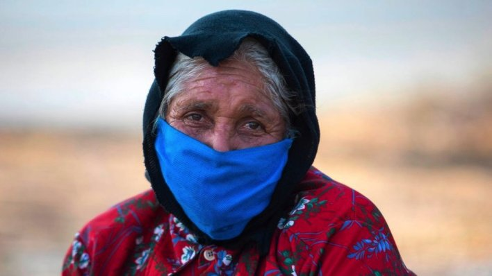 An elderly woman wears a face mask as a preventive measure against the spread of the new coronavirus, COVID-19 in Managua, Nicaragua.