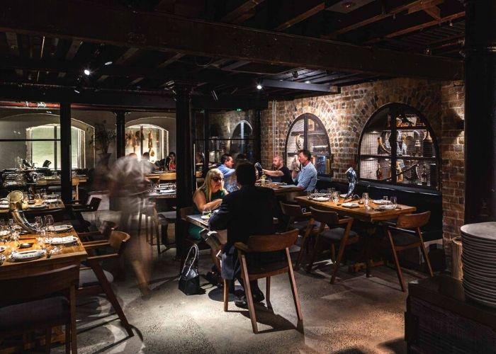 patrons seated at Mjølner Melbourne, a viking themed restaurant