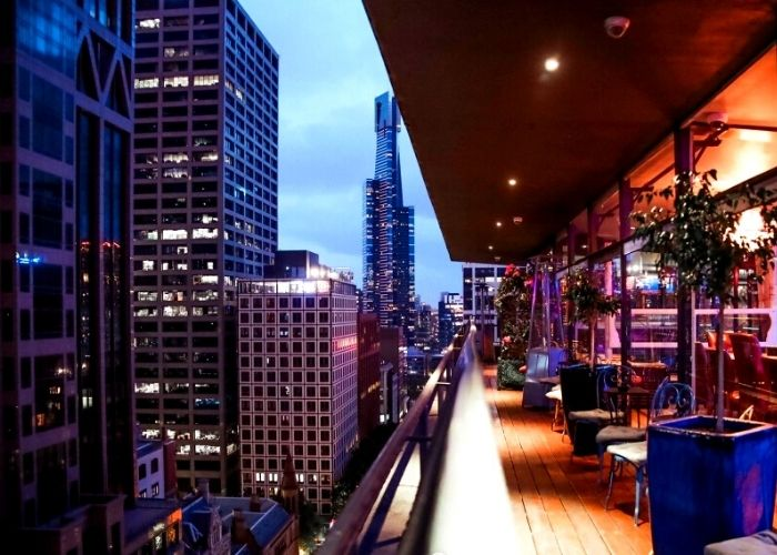 stunning melbourne cbd view from 15th floor of daHa rooftop bar lounge & club eden nightclub balcony with plants and city lights
