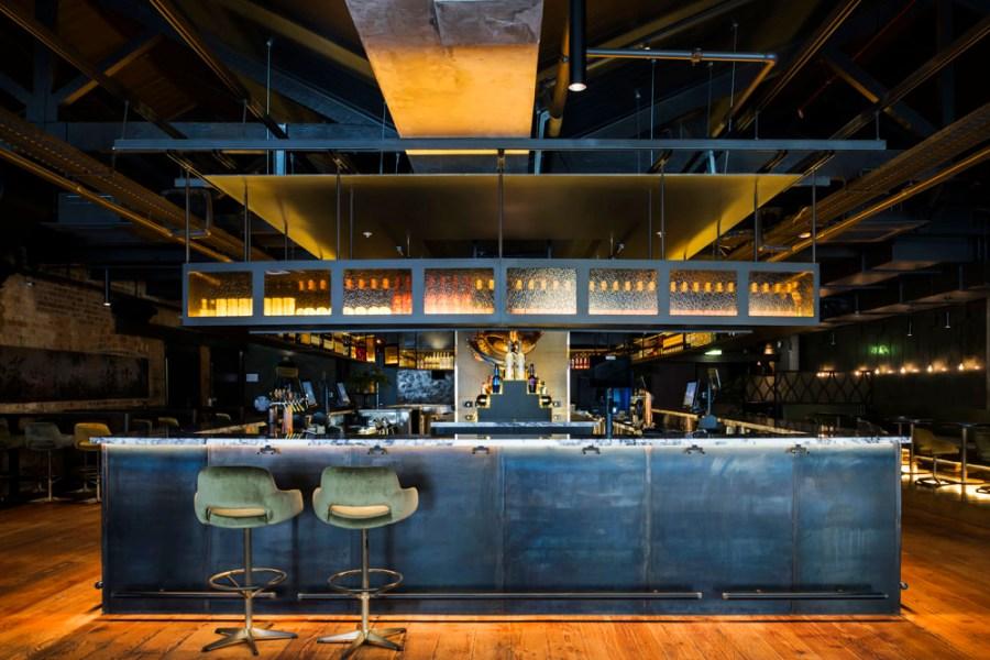 main blue upstairs bar with two bar stools at diesel bar