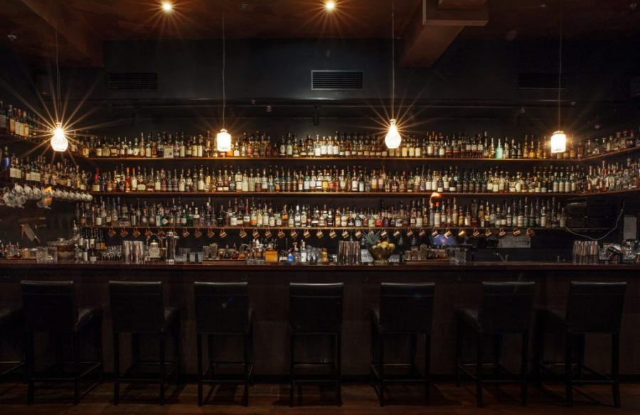 Eau de Vie hidden cocktail and whiskey bar in melbourne with bar stools and four down lights