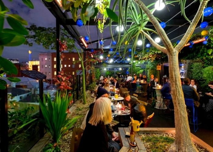 patrons dining on rooftop bar in Melbourne cbd