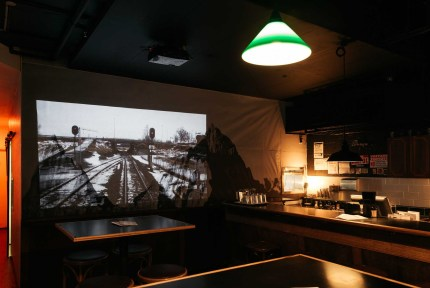 down light and projector screen at saving grace bar