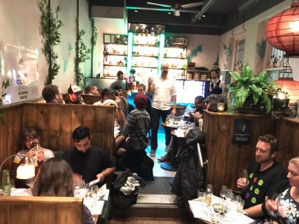 full house of diners eating at melbourne hardware lane restaurant