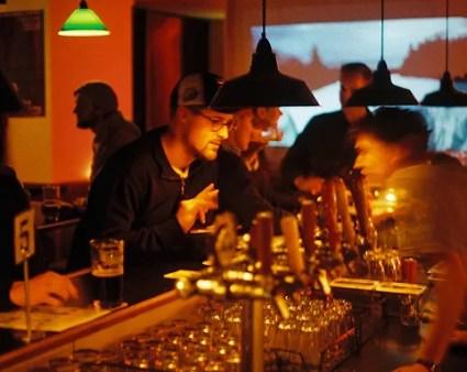 men ordering tap beer at saving grace melbourne