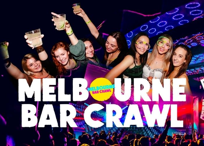 large music concert with pretty girls drinking with glow sticks on melbourne bar crawl night event