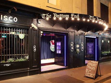 the bottom end front entrance street view with happy hour sign