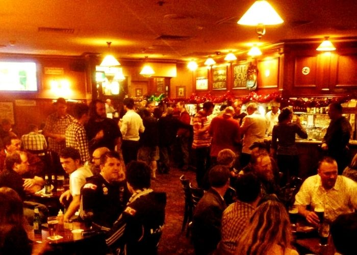 busy crowd drinking inside the Charles dickens pub