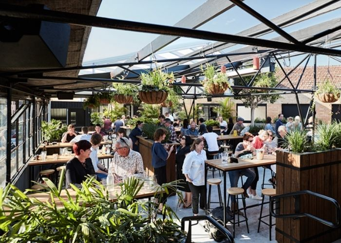 patrons drinking at the corner hotel rooftop beer garden in Richmond