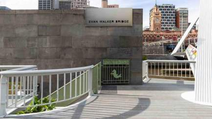 white railings of evan walker bridge with stairs down to ponyfish cafe