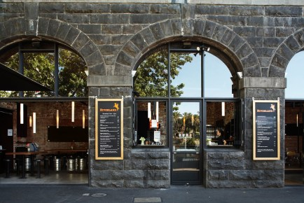 outside of stone arch on federation wharf vault of riverland bar in Melbourne