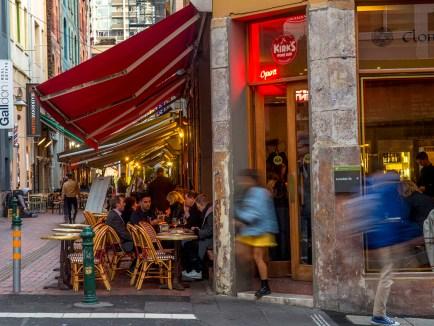 street view of laneway diners at kirks bar restaurant on Melbourne's hardware lane under red awning