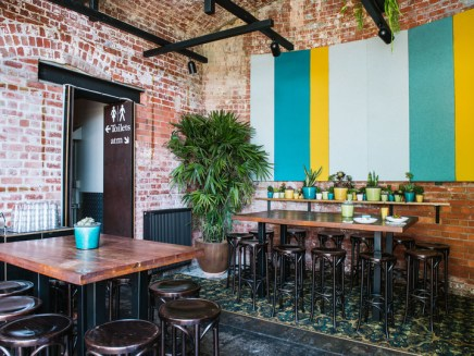 inside riverland function all with brick walls and bar stools inside federation wharf vaults