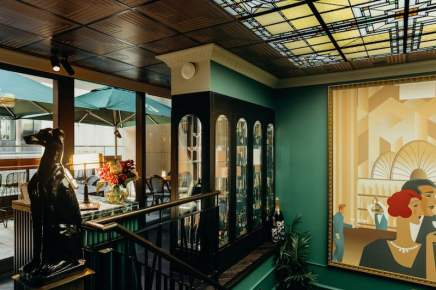 main bar entrance with crystal wine glass display, beautiful wall paining and outside balcony with green umbrellas