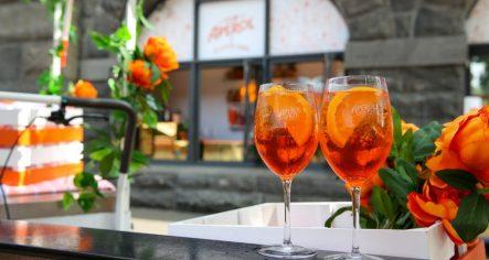 two orange cocktails with orange flowers at riverland bar
