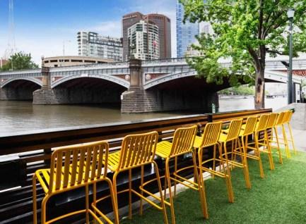 outdoor beer garden overlooking yarra river and princess bridge in melbourne, Australia