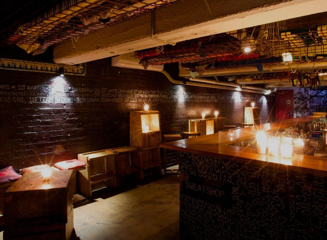 large industrial themed restaurant with candles on wooden furniture