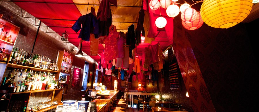 silk clothes hanging from asian themed seamstress bar in melbourne cbd