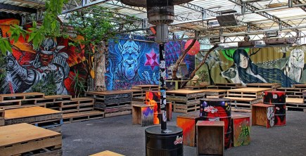 graffiti murals inside section 8 with wooden pallets