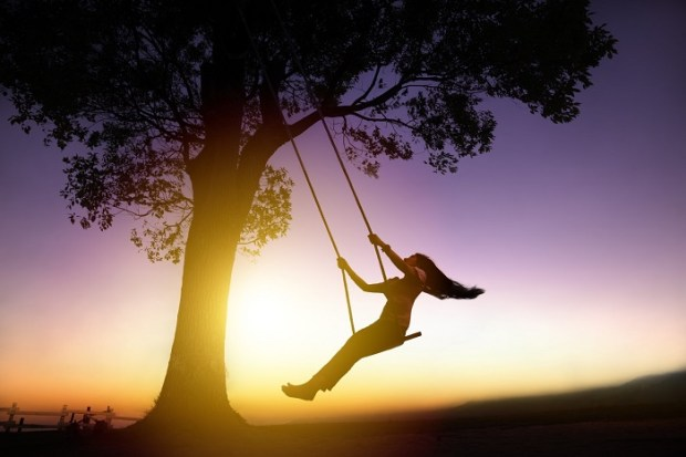 1_Woman on swing at sunset