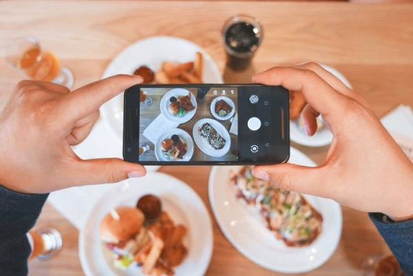 person-food-smartphone