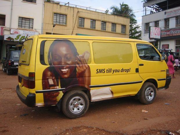 Uganda_-_ad_on_van_in_Kampala