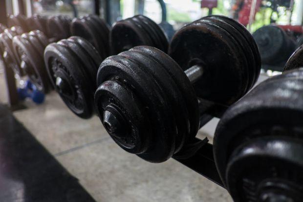 weight training in gym bodybuilding equipment