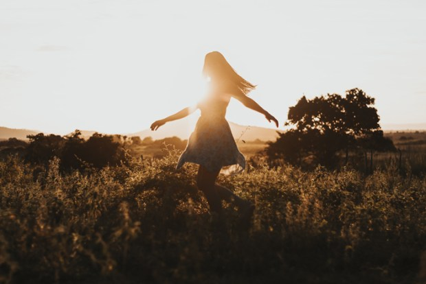 woman-turning-around-on-green-fields-2868441