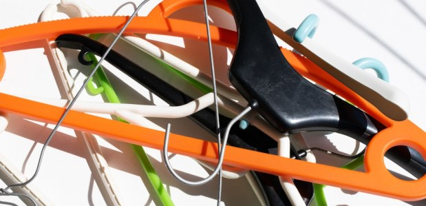 Many wooden hangers and plastic.