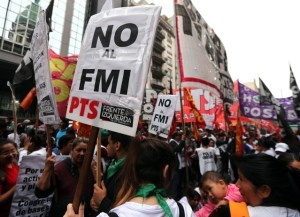 "A woman holds a sign that reads ""No to the IMF"" during a protest outside the Congress in Buenos Aires"