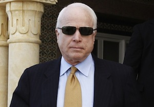 U.S. Senator John McCain leaves after a meeting with Tunisia's Prime Minister Mohamed Ghannouchi in Tunis