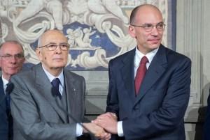 Giorgio Napolitano and Enrico Letta cling together