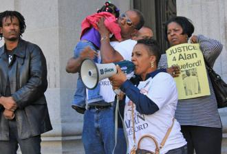 Alan's mother Jeralynn Blueford speaks on the steps of Oakland City Hall