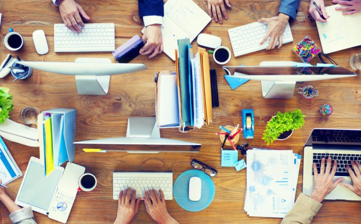 photodune-8797917-group-of-business-people-working-on-an-office-desk-m