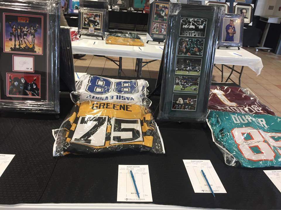 Auction items from The Propeller Club of Tampa Bay's 'Shrimperoo' fundraiser