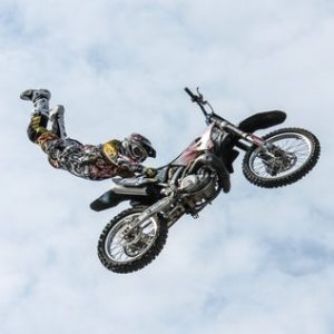 guy on a dirt bike doing a stunt in the air