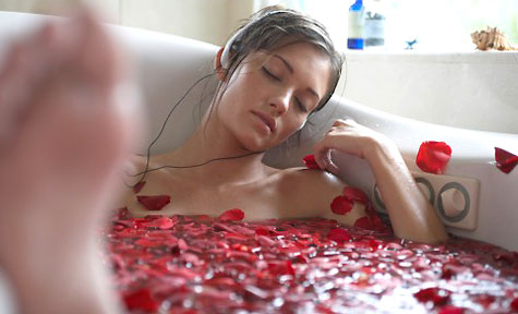 Maybe it's the music? Maybe it's the rose petal bath? Either way she looks pretty stress free...