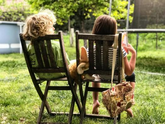kids sitting on chairs