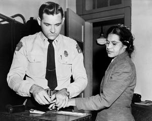 Rosa Parks is fingerprinted at a police station after her arrest in Montgomery, Alabama.