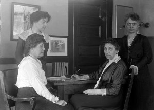 Julia Lathrop, Head of Children's Bureau, Labor Department, with Assistants