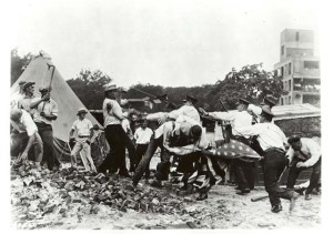 """""""Bonus Marchers"""" and police battle in Washington, DC. The marchers came to Washington, DC, to demand their veterans """"bonus"""" payment early from Congress. After several months of camping near the Anacostia River and after several confrontations with police, federal, troops drove the marchers from the city."""