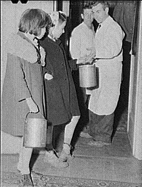 Two children pick up pails of soup for their families as relief to the dismal conditions of the Great Depression era.