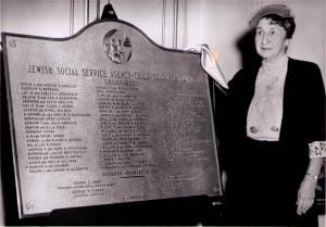 "Mrs. Charles (""Aunt Minnie') Goldsmith with Child Guidance Clinic Dedication Plaque c. 1953"