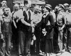 Secretary of Labor Frances Perkins shaking hands with Carnegie Steel Workers during the National Recovery Act drive, July 1933.