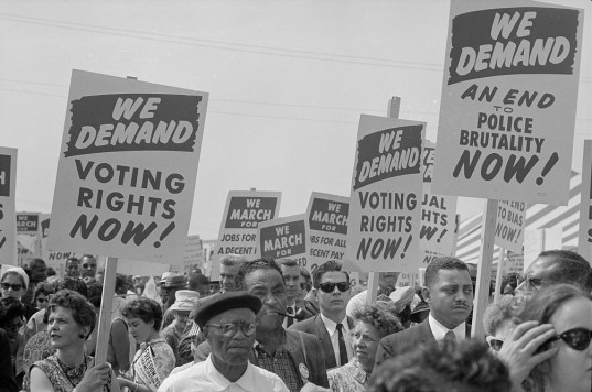 Marchers with signs at the 1963 March on Washington