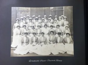 Photograph of a graduating class of nurses from St. Vincent's School of nursing. They are wearing uniforms with caps