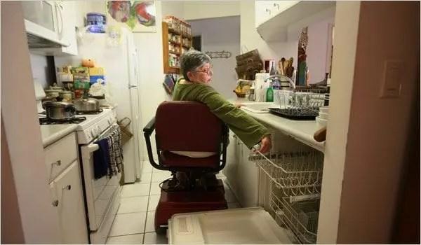 Woman in Wheelchair In the Kitchen 1
