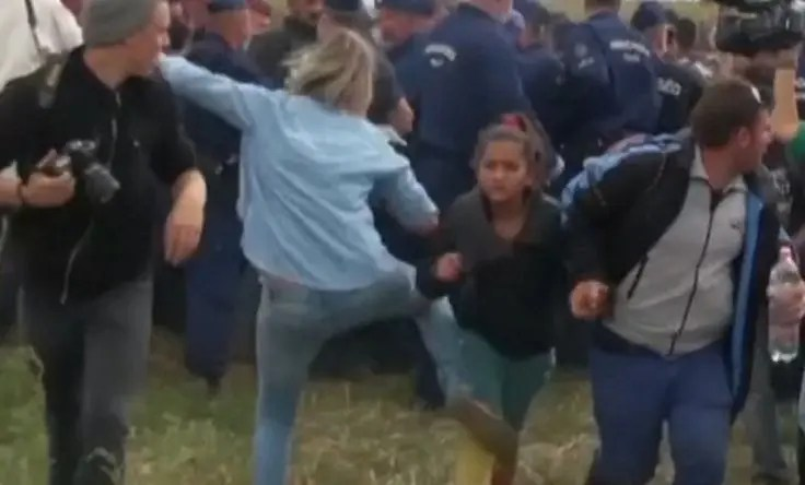 Hungarian Camerawoman trips refugee child to prevent them from eluding police.