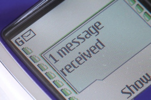 "A picture of a Nokia phone with ""1 message received"" message showing"
