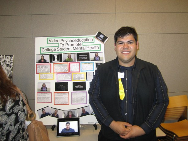 Ignacio Standing In Front of His Poster